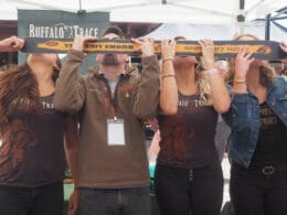 Image of people doing a skishot at the Breckenridge Hogfest: Bacon & Bourbon in Colorado