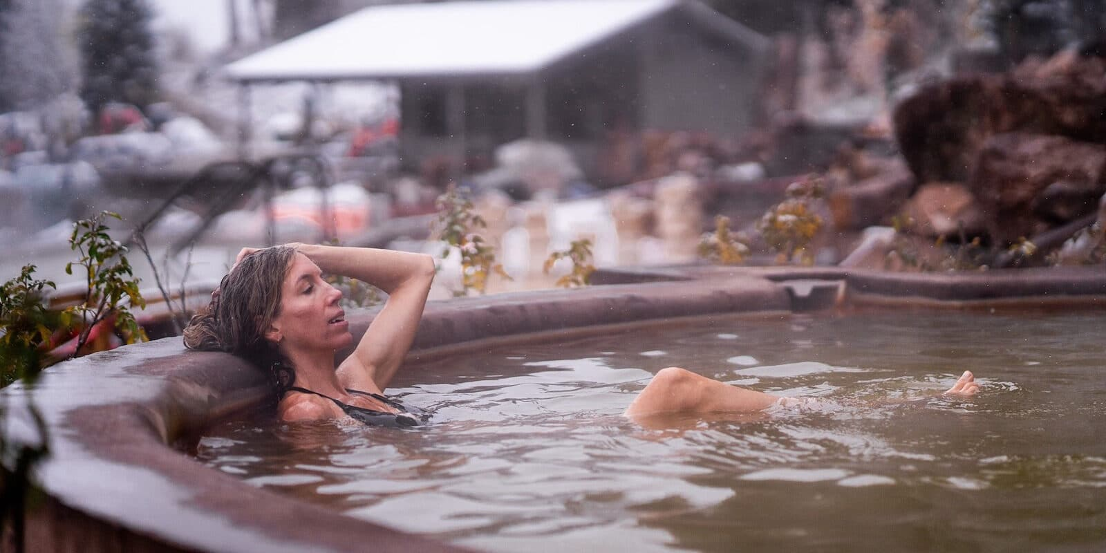 Image of a woman soaking in a mineral pool at the Durango Hot Springs Resort and Spa
