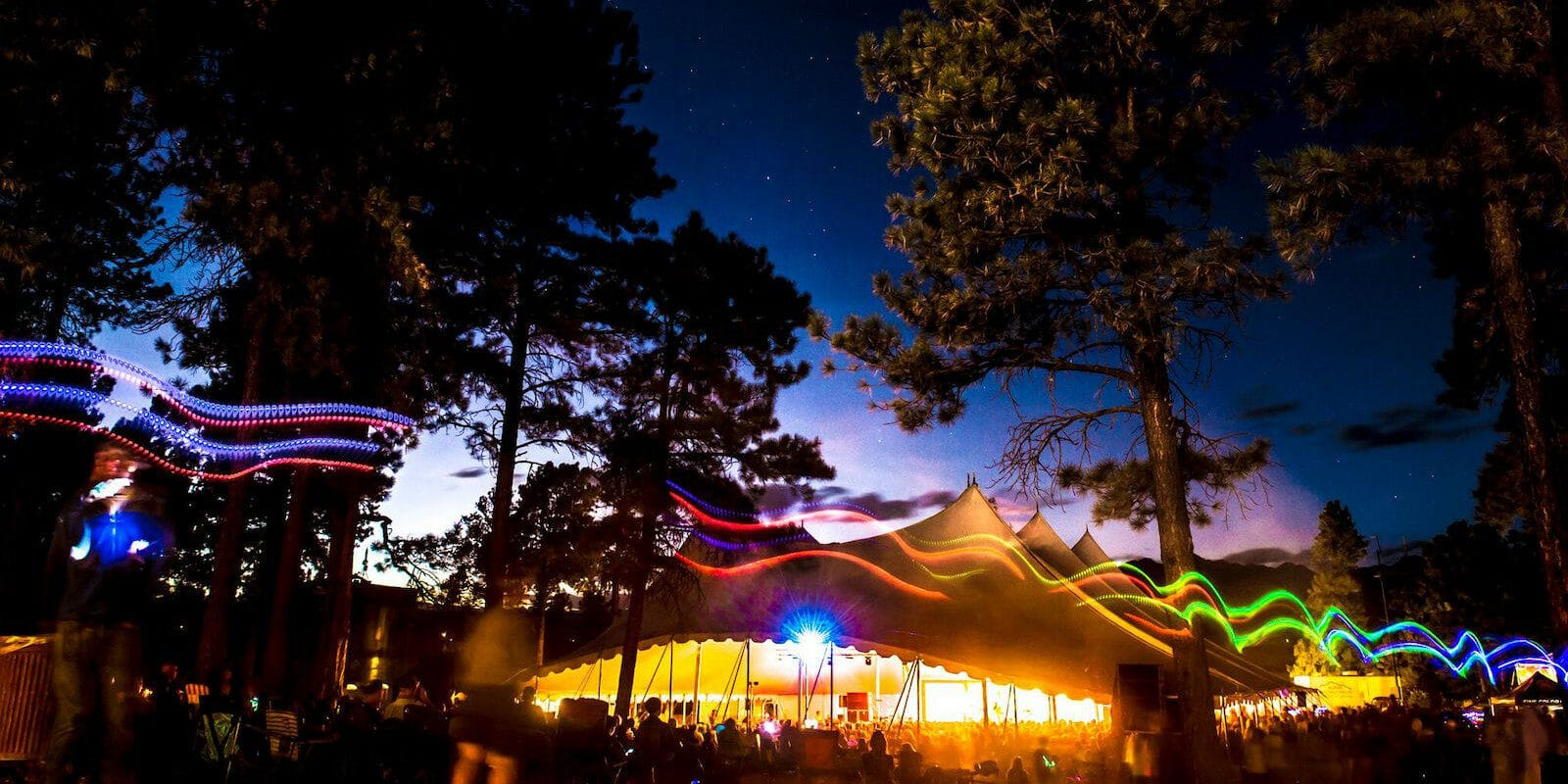 Image of the tent at night at the Four Corners Folk Festival in Pagosa Springs, Colorado
