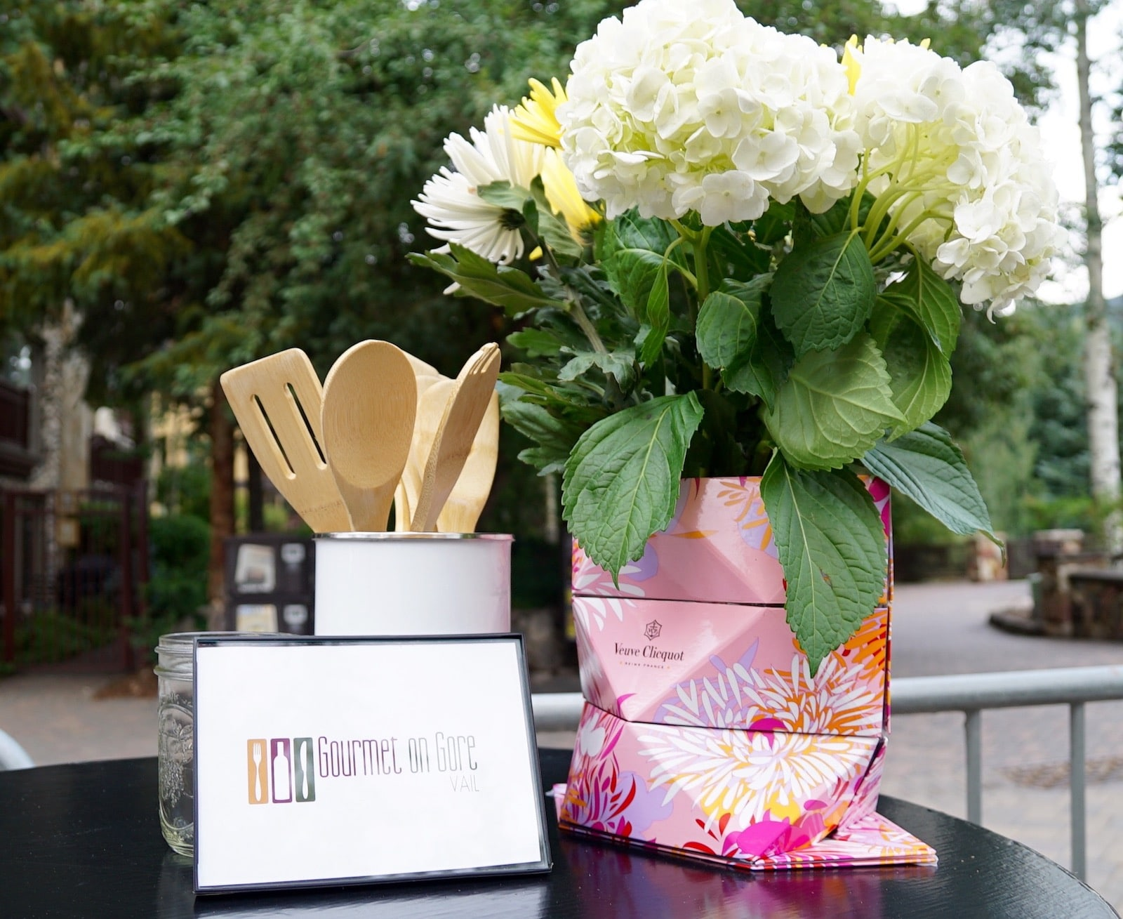 Image of flowers and a sign for Gourmet on Gore