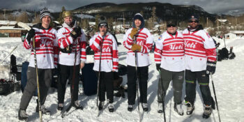 Image of some of the players from the Pond Hockey Classic in Grand Lake, Colorado