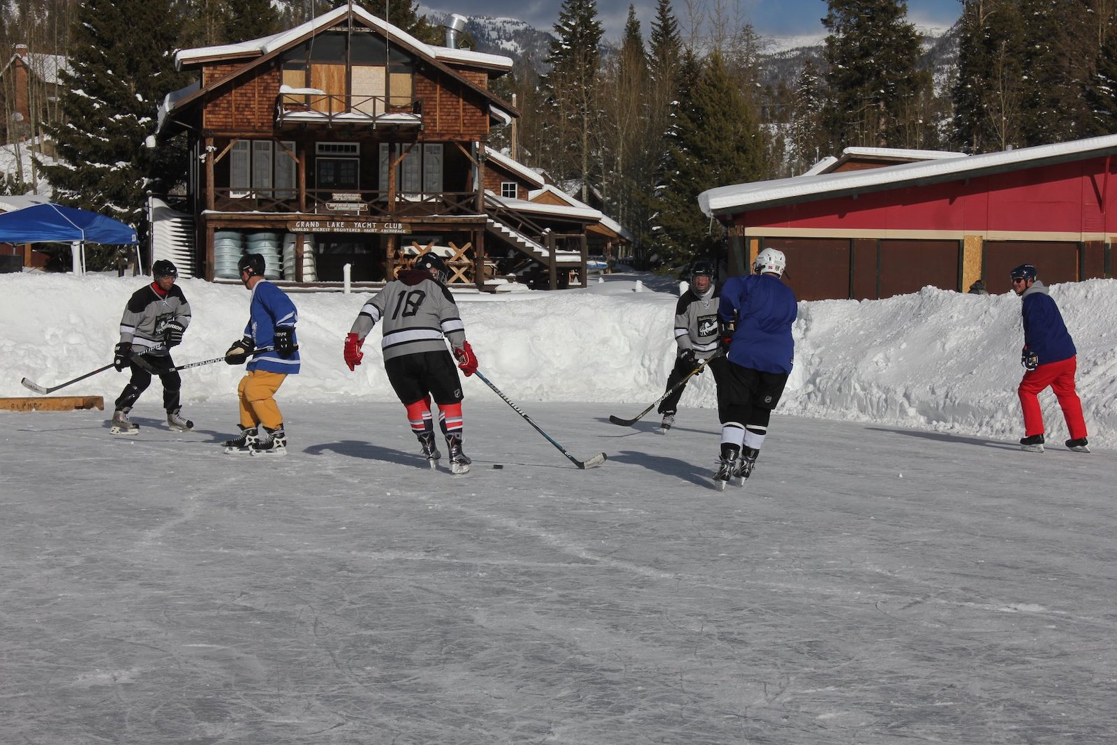 Image of people competing in the Grand Lake Pond Hockey Classic in Colorado