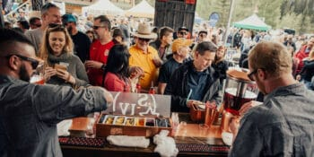 Image of bartenders at the Bacon and Bourbon Festival in Keystone, Colorado