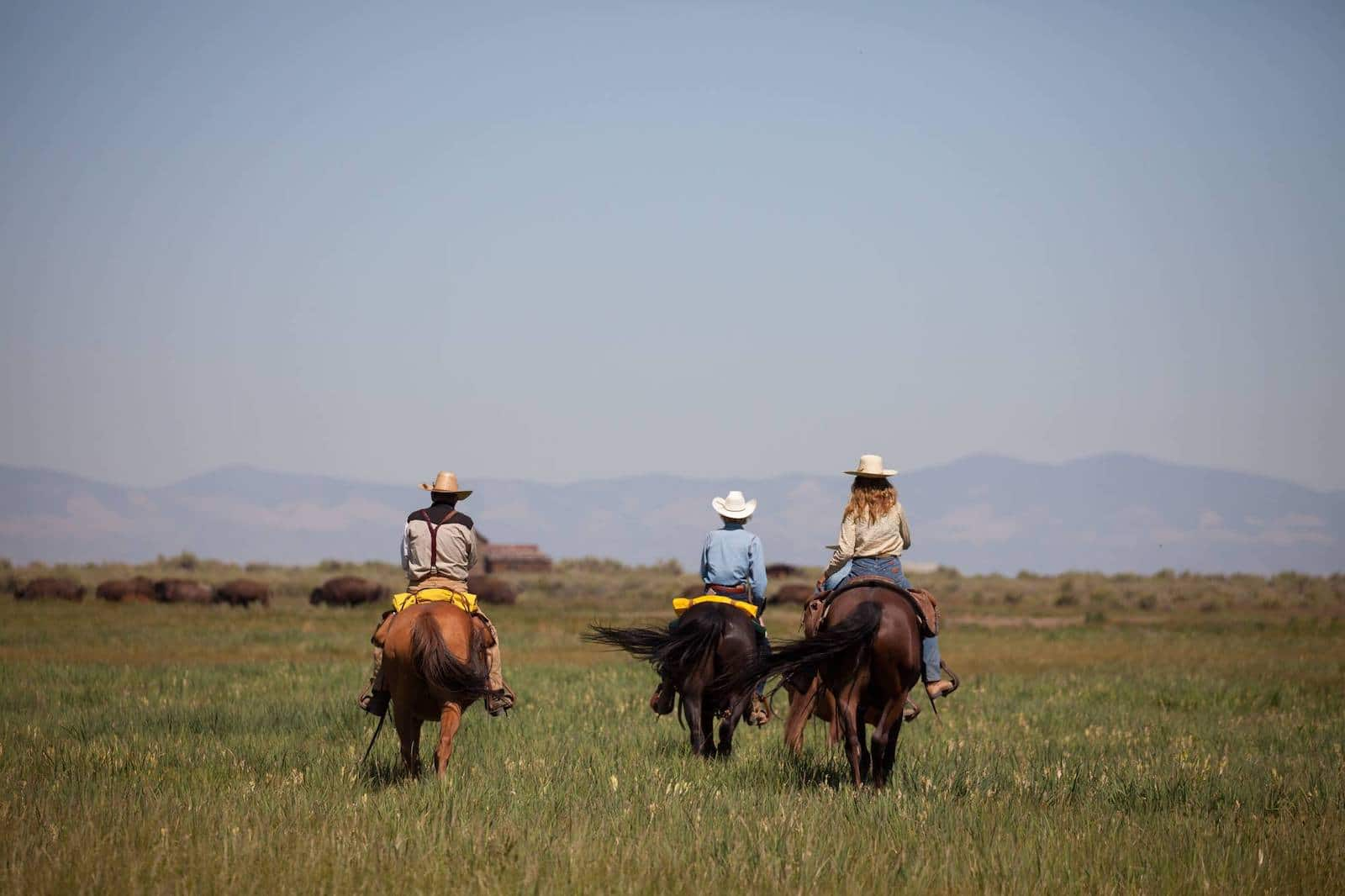 Image of people riding horses at Ranchlands Zapata Ranch in Mosca, Colorado
