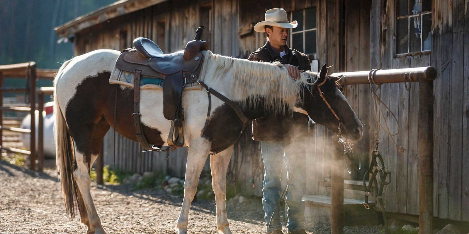 Image of a cowboy and his horse at the Rawah Guest Ranch in Colorado
