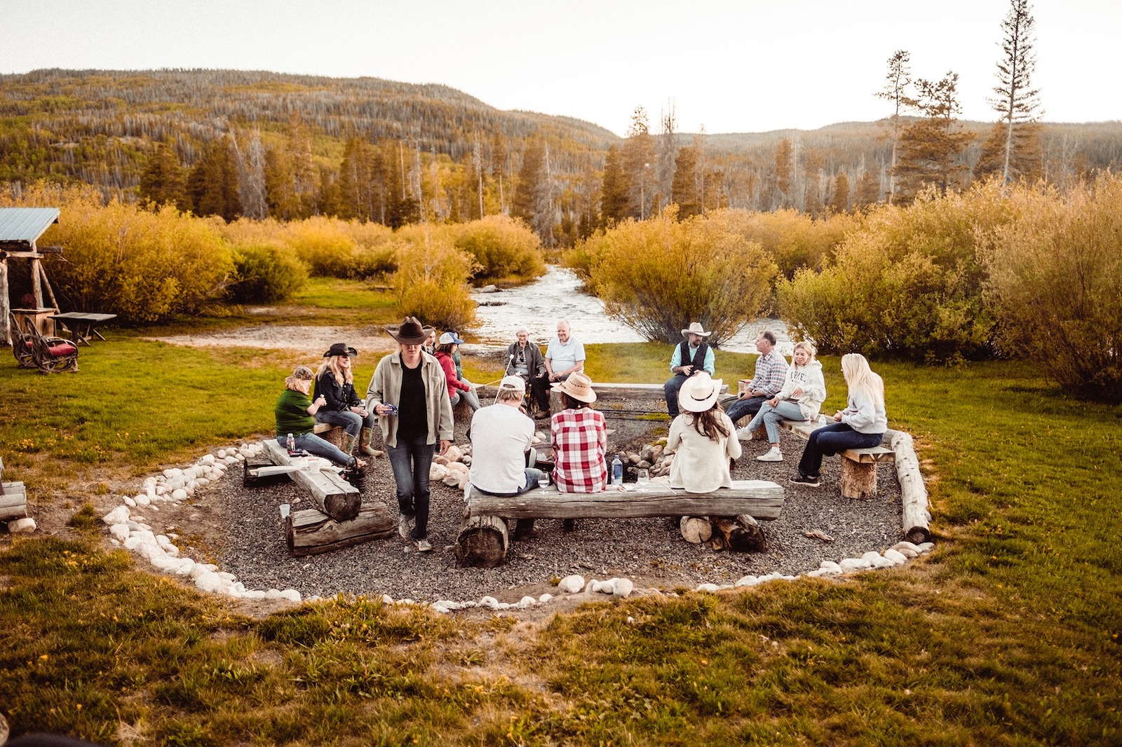 Image of people around the campfire at Rawah Guest Ranch in Glendevey, ColoradoColorado