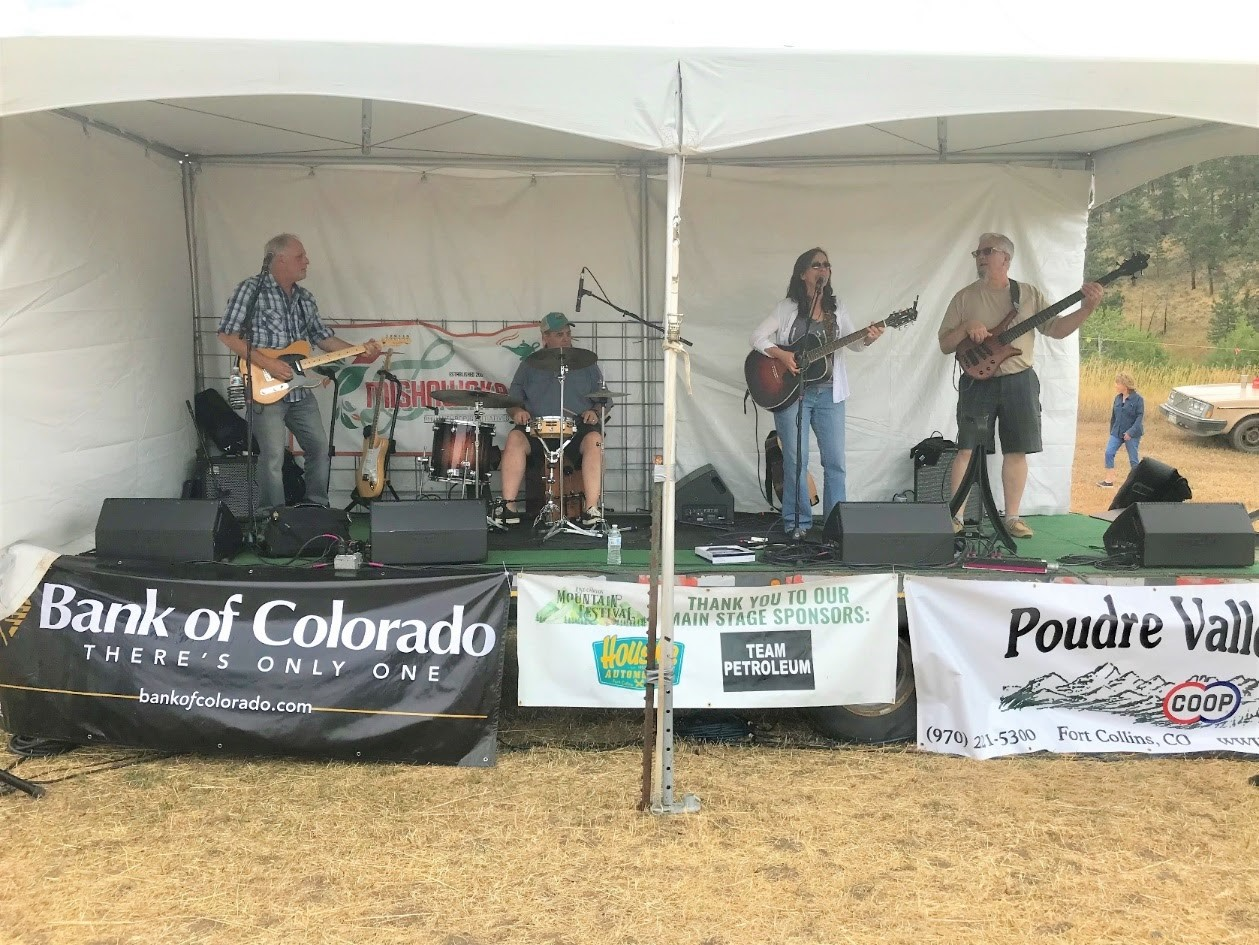 Image of a band playing at the Rist Canyon Volunteer Fire Department Mountain Festival in Bellvue, Colorado