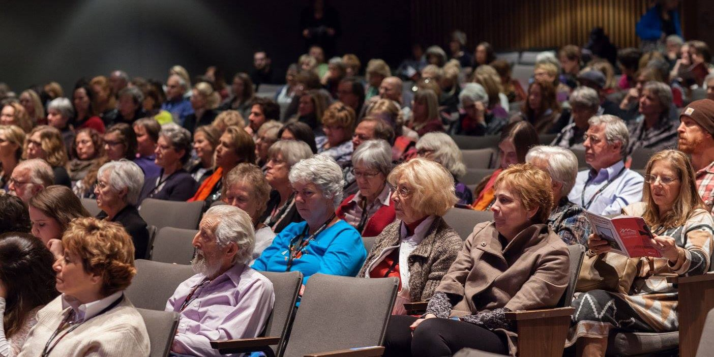 Image of people in the auditorium at the Rocky Mountain Women's Film Festival in Colorado