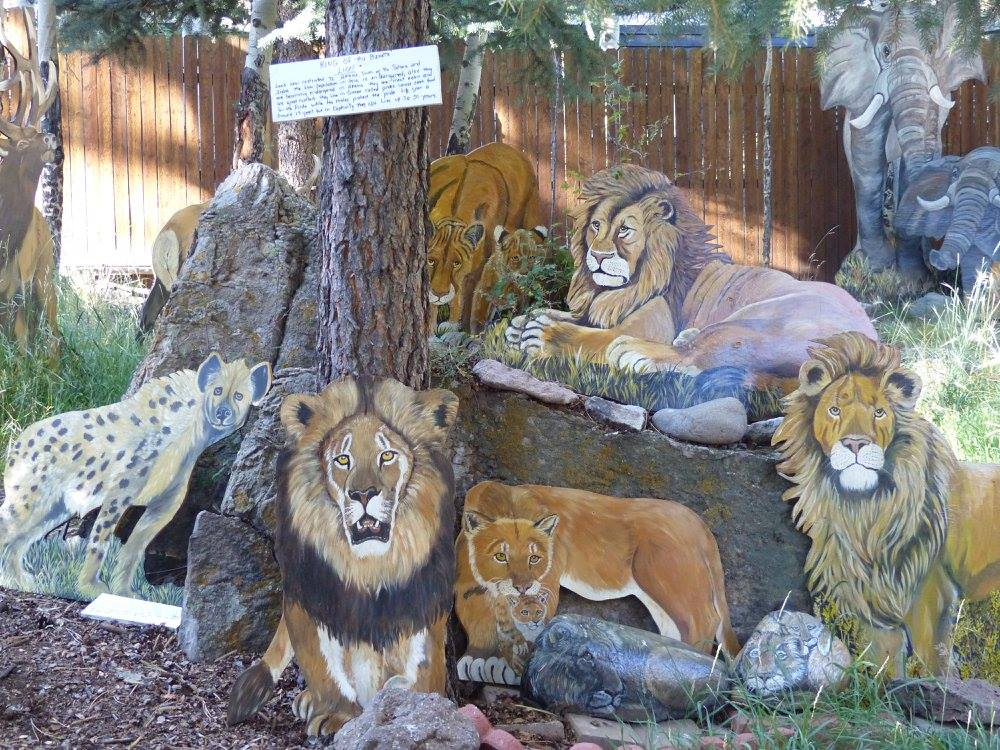 Image of painted big cats at Sweet's Wildlife Preserve Art Zoo in Lake City, Colorado