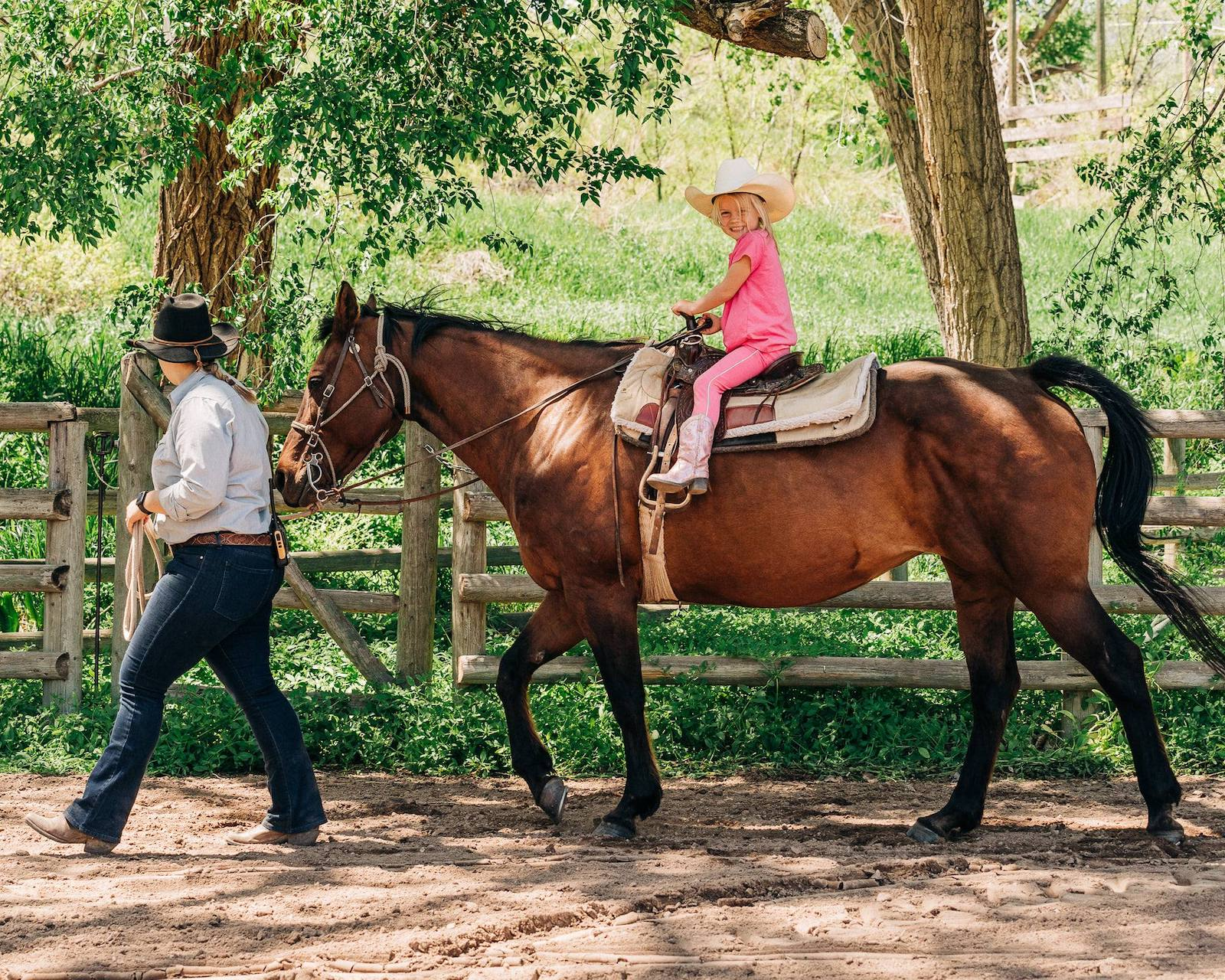 Image of a little girl riding a horse at Sylvan Dale Guest Ranch in Loveland, CO