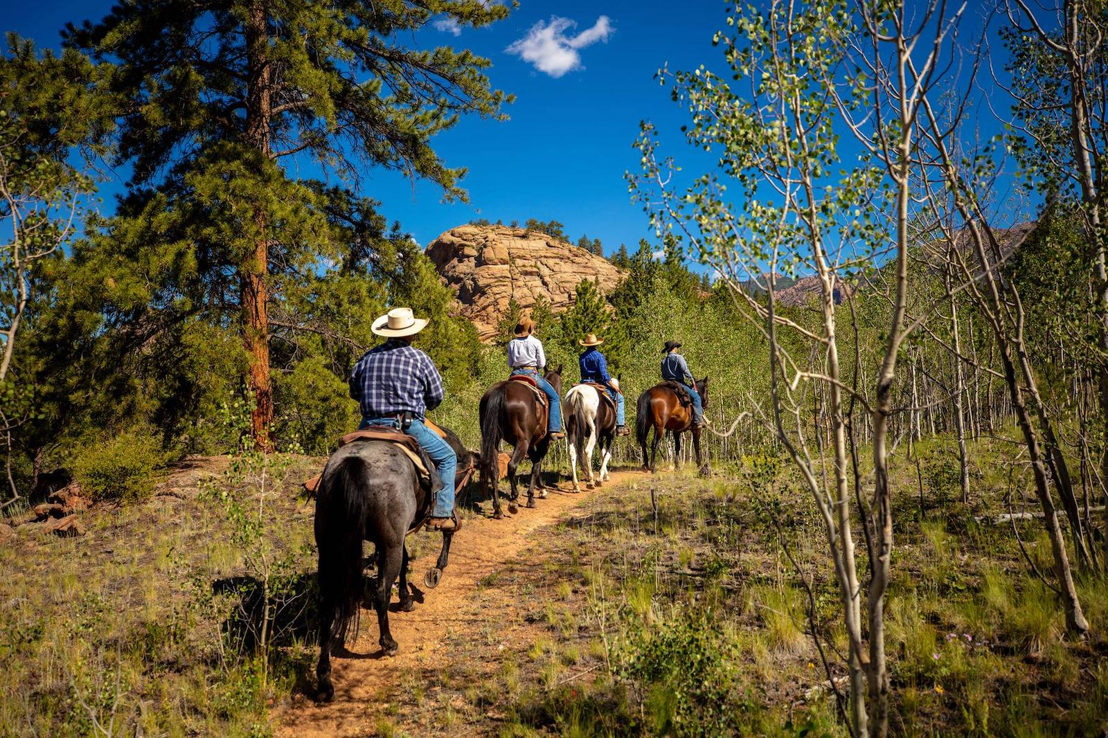 Image of people riding horses at Tarryall River Ranch in Lake George, Colorado