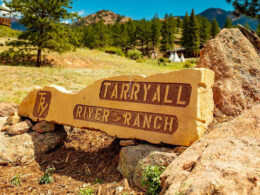 Image of a carved boulder with the logo for Tarryall River Ranch in Lake George, Colorado