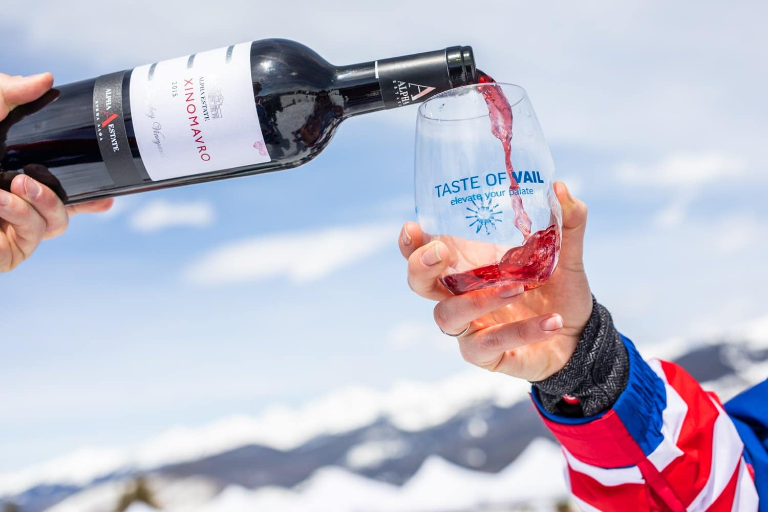 """Image of a """"Taste of Vail"""" wine glass being filled with red wine"""