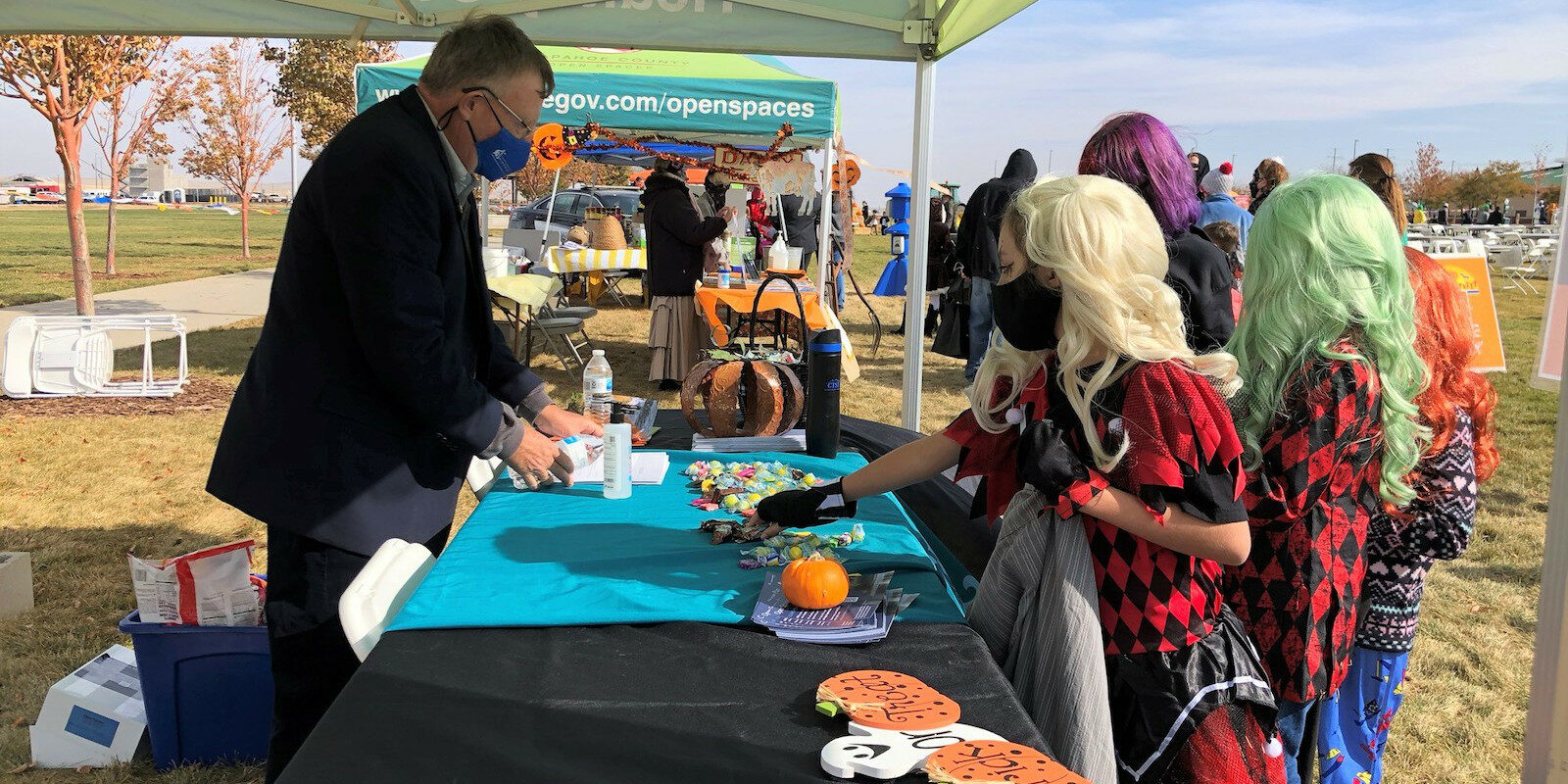 Image of children trick-or-treating at Arapahoe County Fairgrounds in Aurora, Colorado