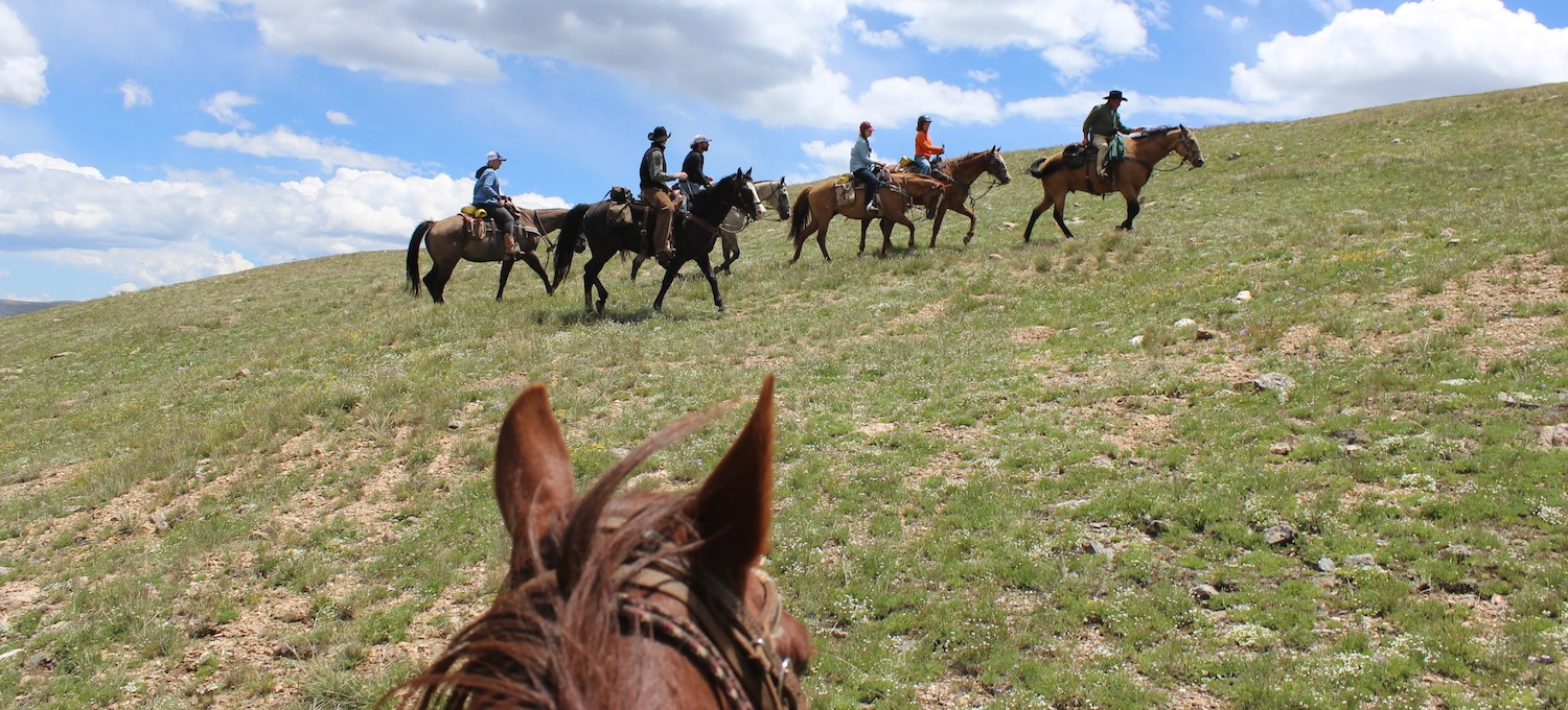 Image of people riding horses at Tumbling River Ranch in Grant, Colorado