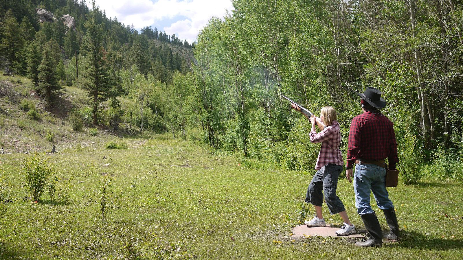Image of a woman skeet shooting at Tumbling River Ranch in Grant, Colorado