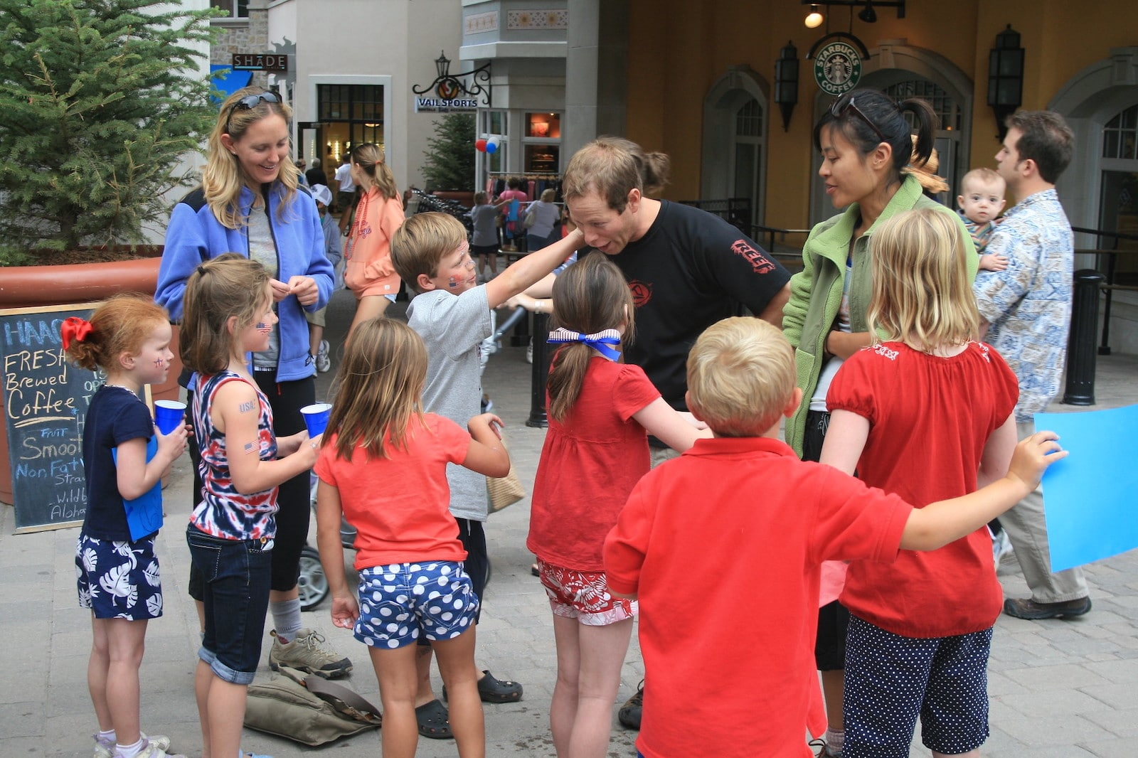 Image of children getting temporary tattoos at Vail's July 4th festivities in Colorado