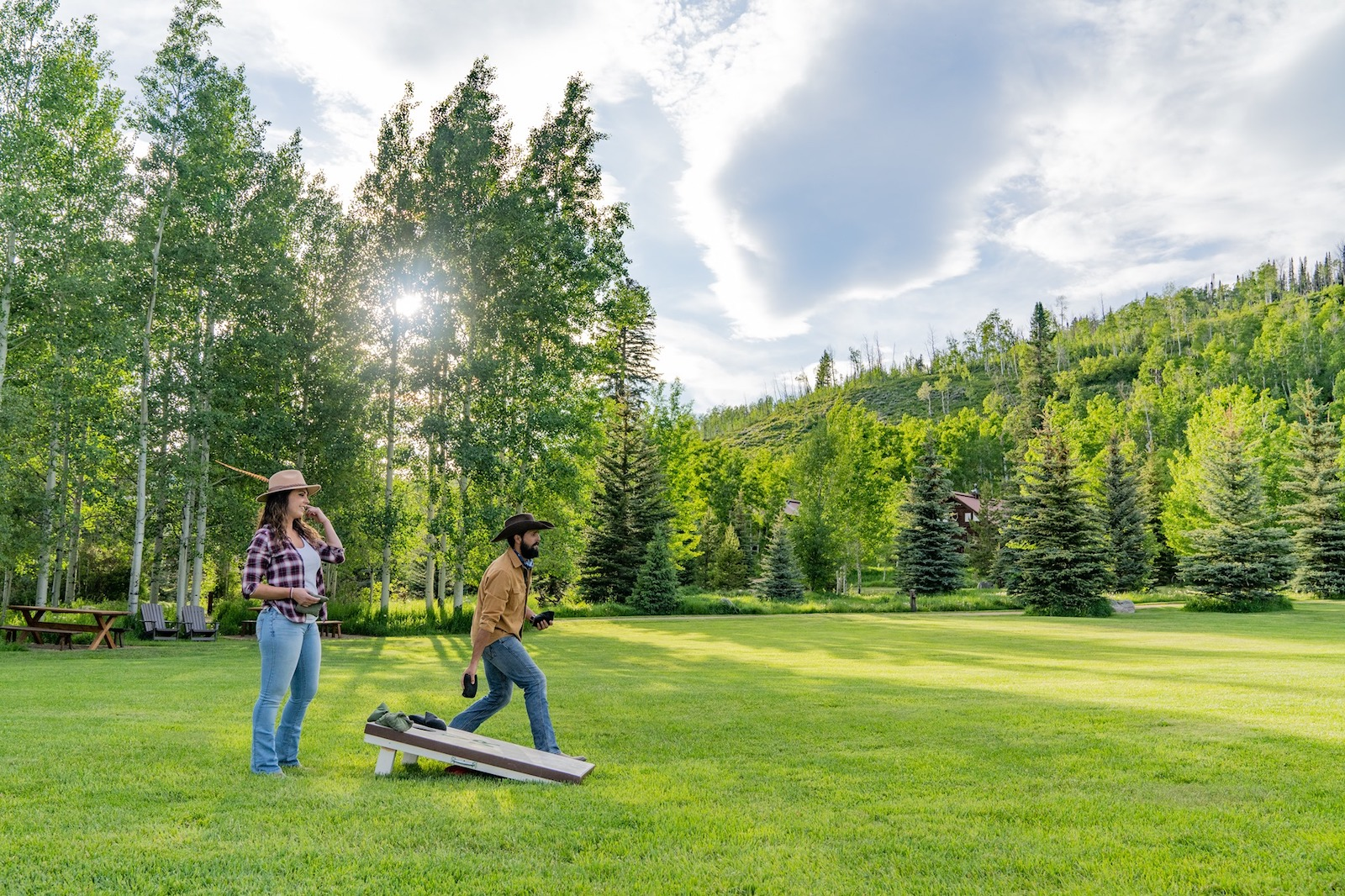 Image of people playing corn hole at Vista Verde Ranch in Clark, Colorado