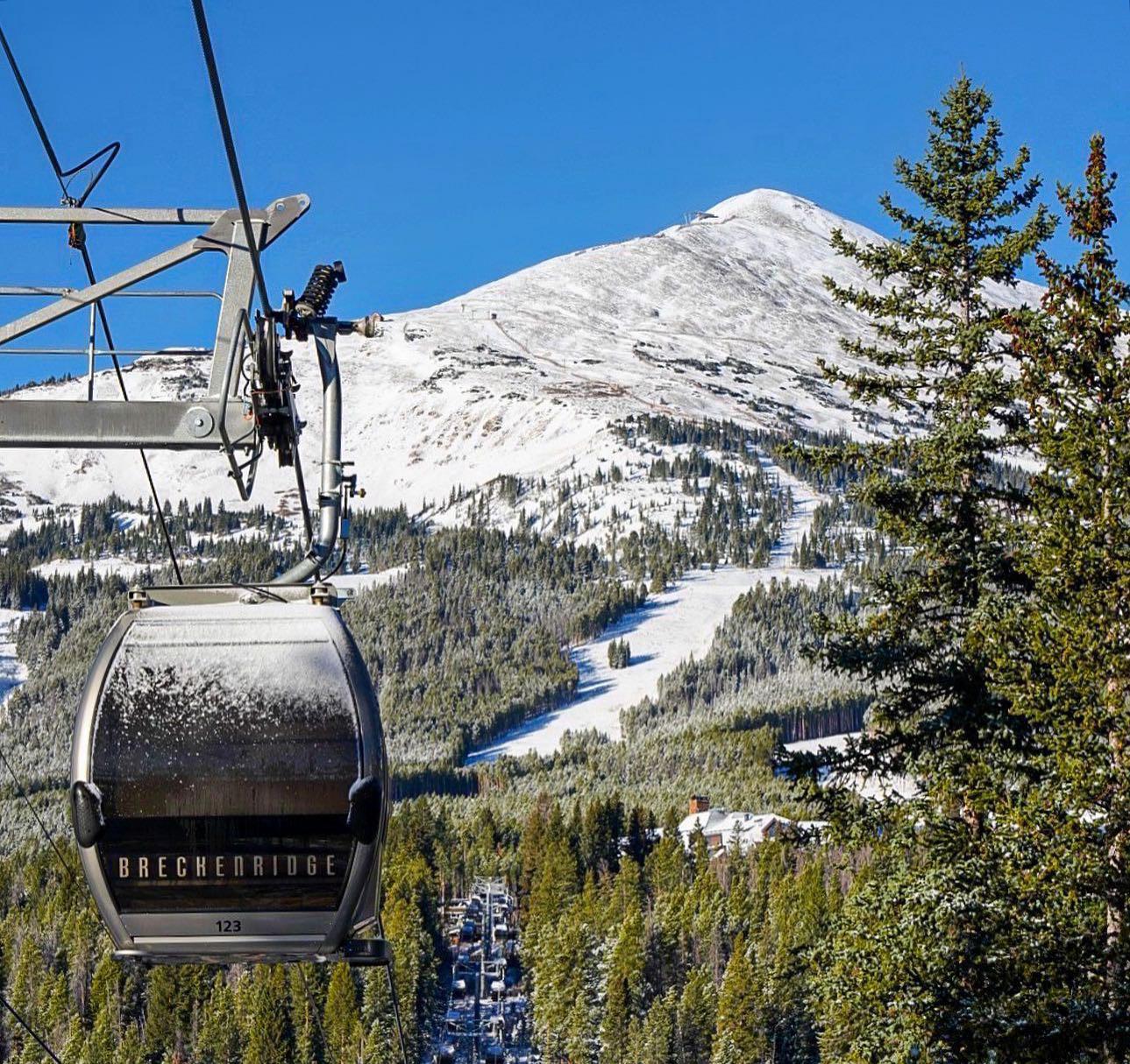 Image of the BreckConnect Gondola going up the snowy mountain in Breckenridge, Colorado