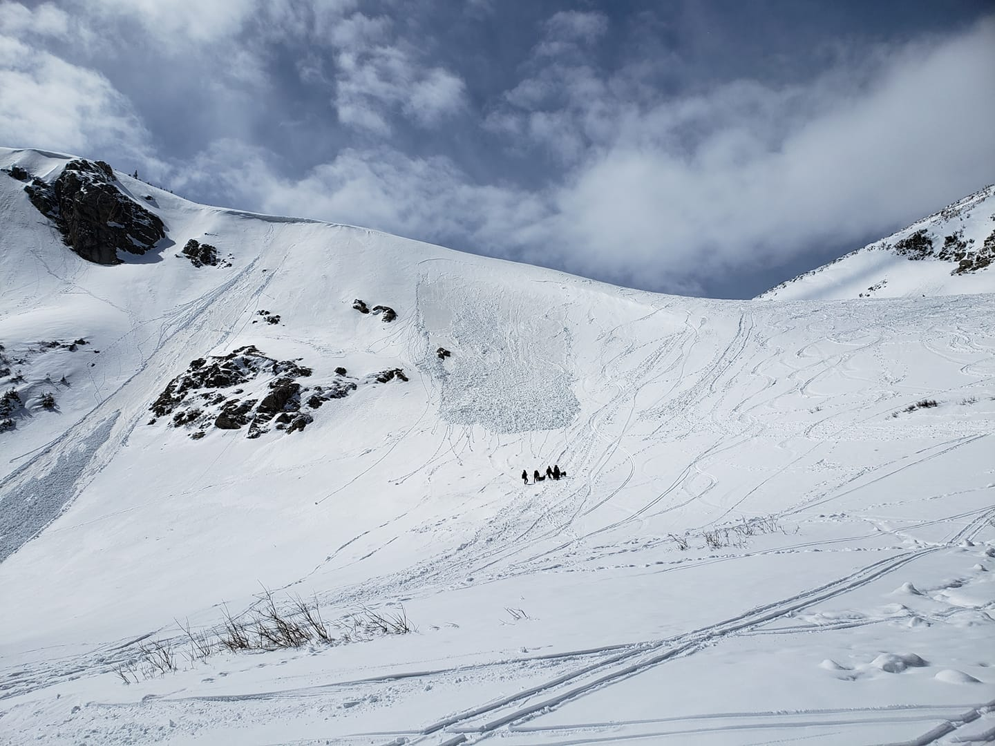Image of people trekking through the snow with the Colorado Climbing Company