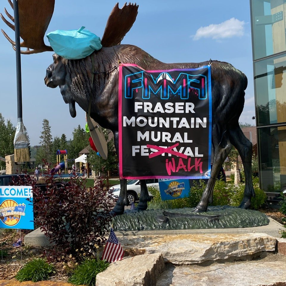 Image of a moose statue with a sign for the Fraser Mountain Mural Festival in Colorado