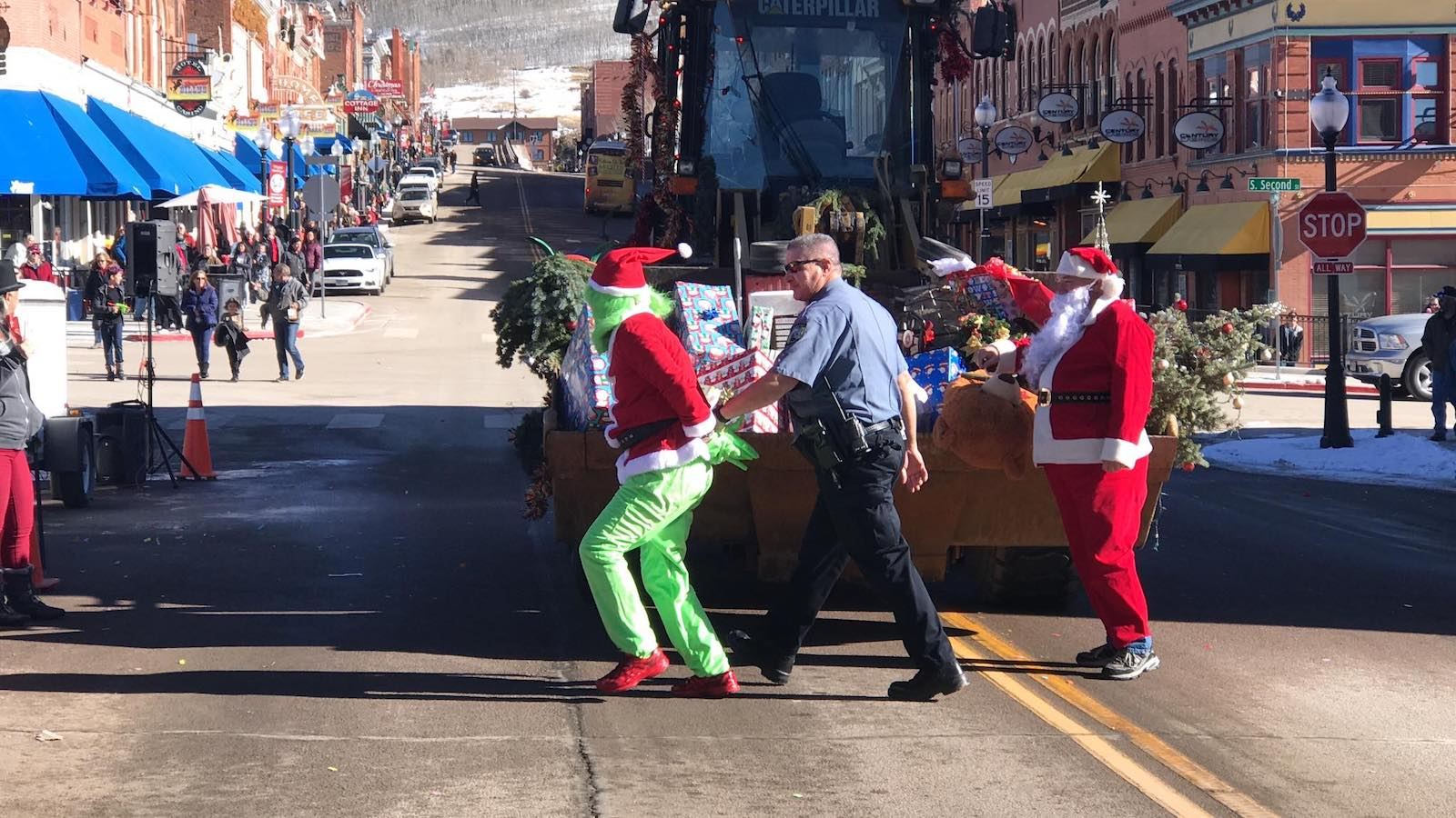 Image of the grinch being arrested while santa watches at Gold Camp Christmas Weekend in  Cripple Creek, Colorado