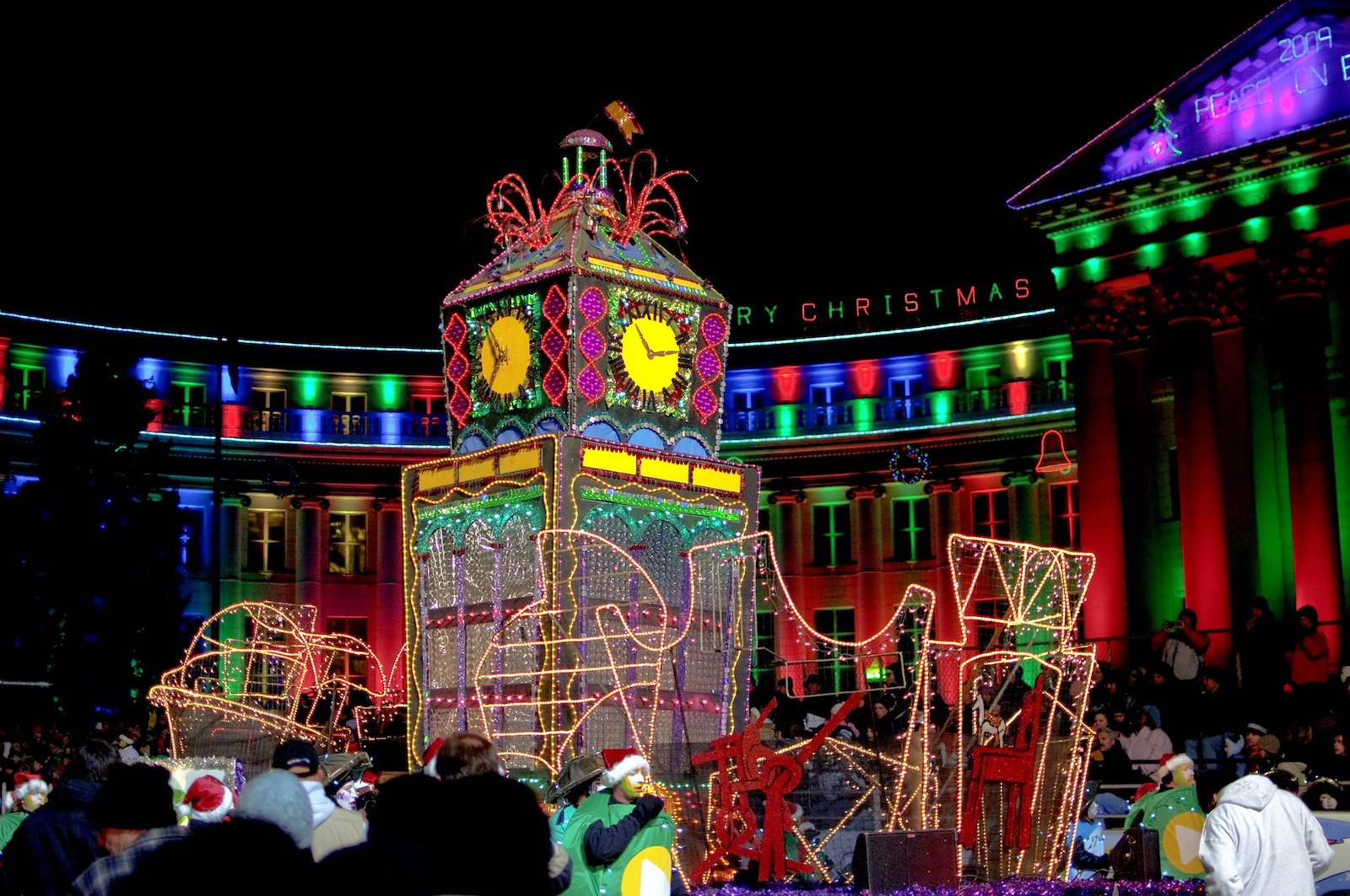 Image of a parade float and holiday lights and Denver's Parade of Lights in Colorado
