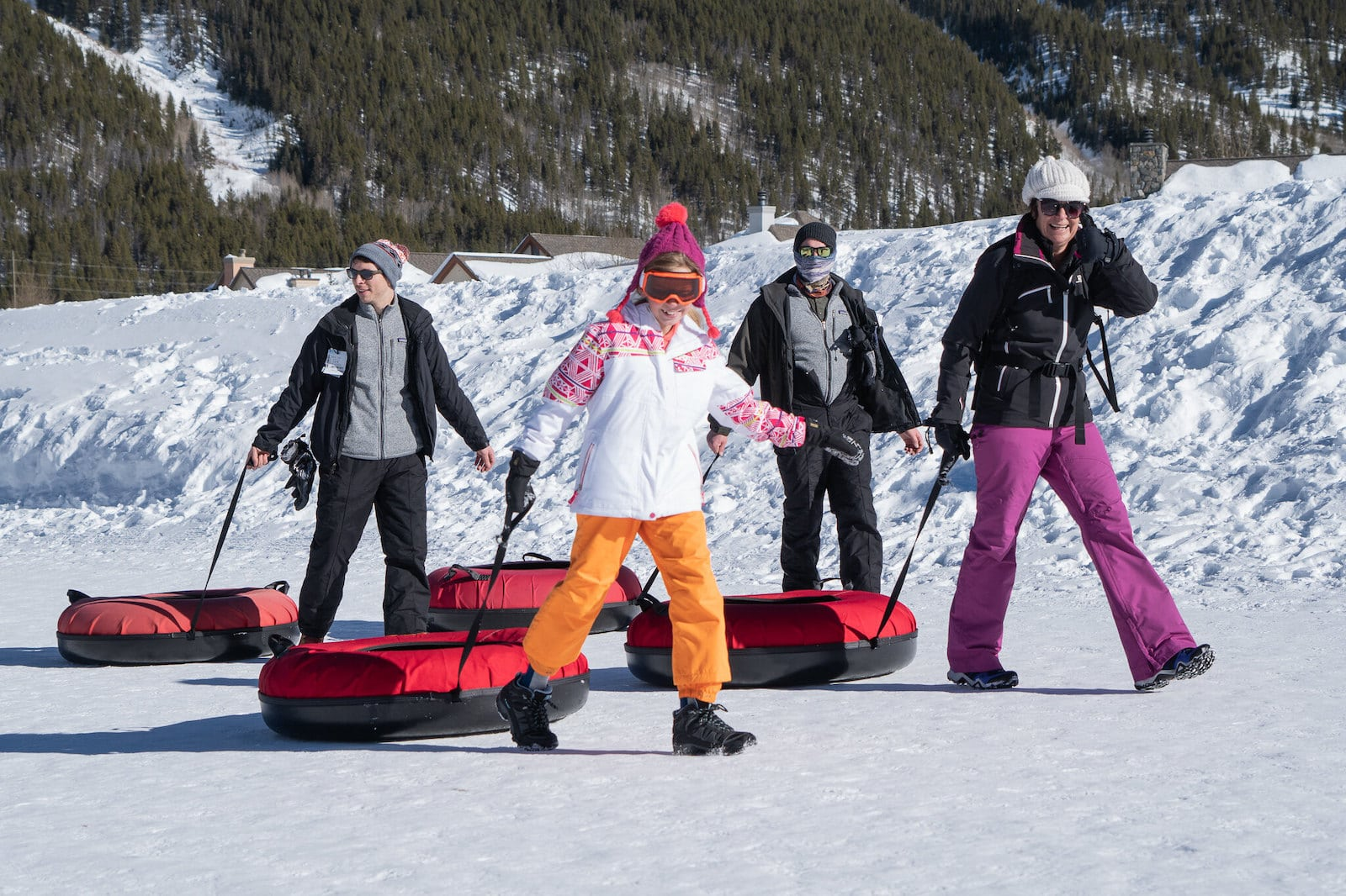 Image of people pulling snow tubes in Copper Mountain, Colorado