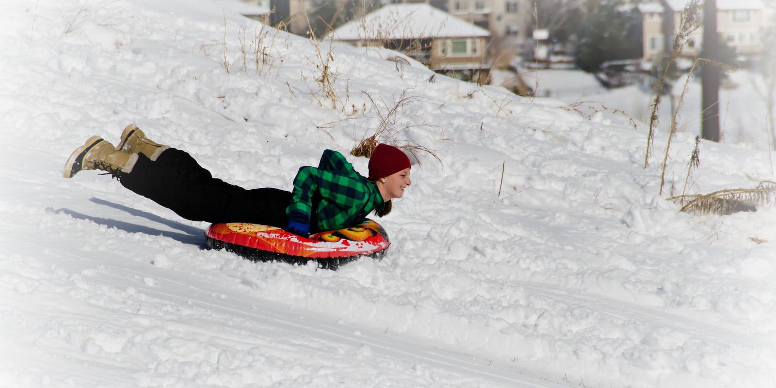 Image of a person snow tubing in Littleton, Colorado