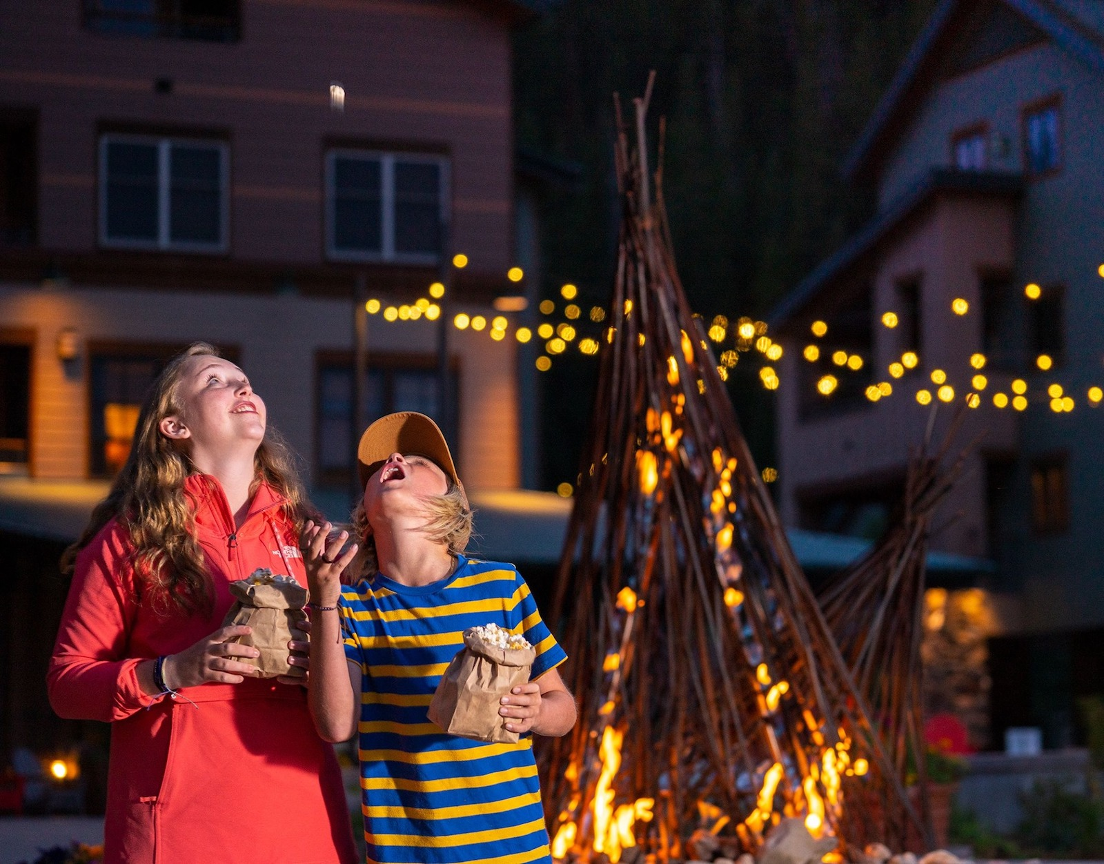 Image of kids next to a campfire looking at the stars at Winter Park Resort in Colorado