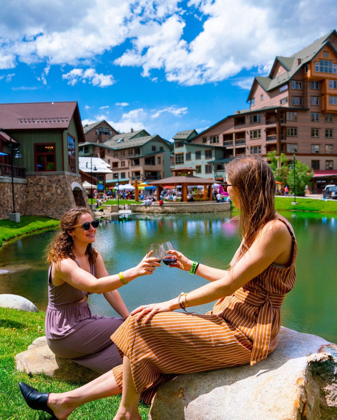 Image of two women enjoying wine at Village Uncorked in Winter Park, Colorado