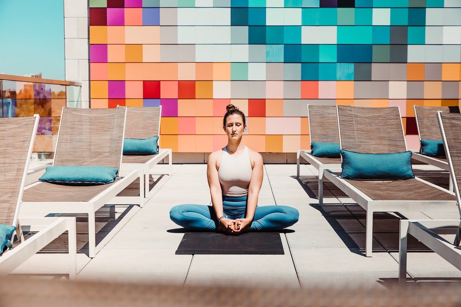 Image of a person doing yoga on the rooftop of Halcyon in Denver, Colorado