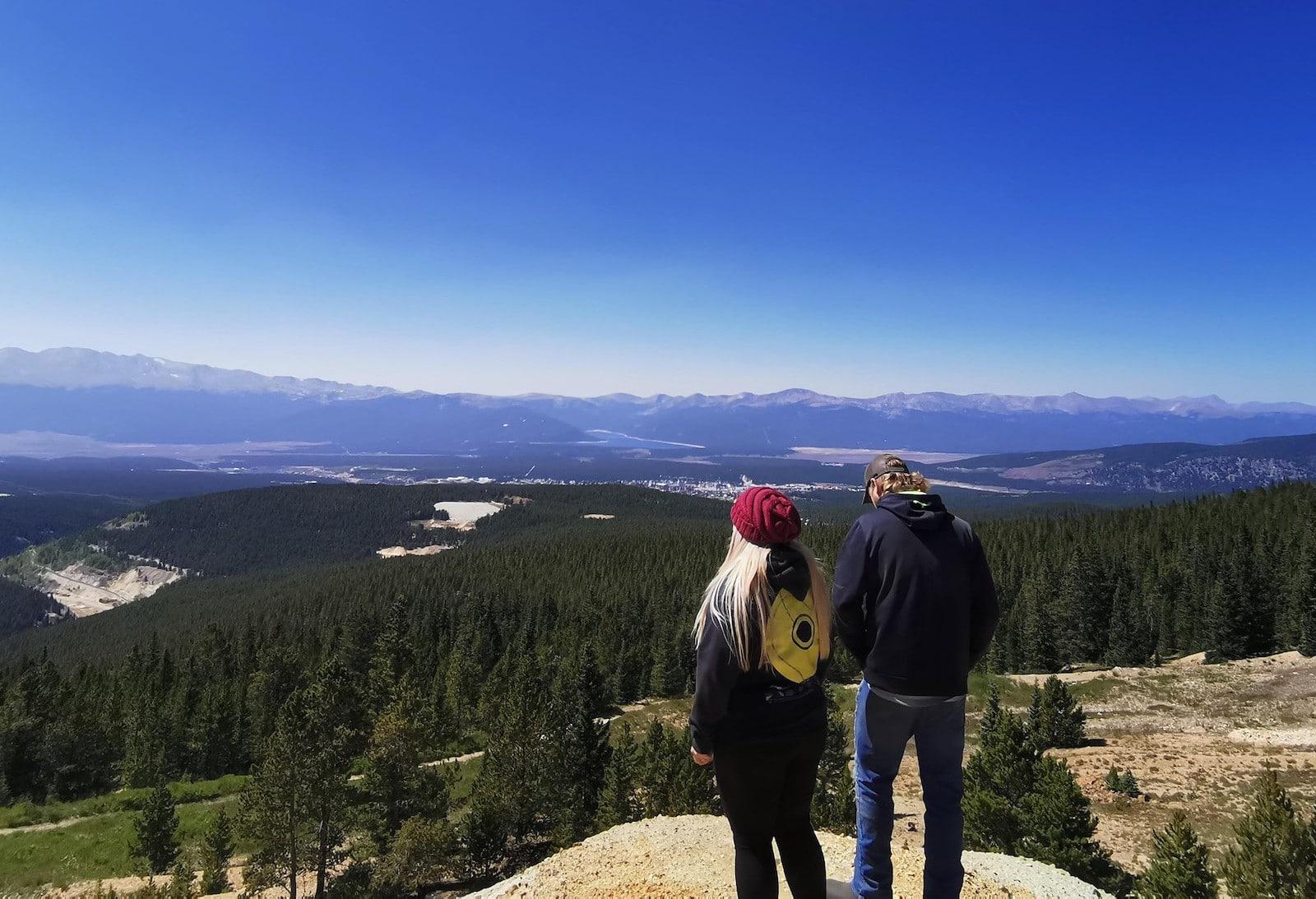 Image of a couple enjoying scenic views on Leadville UTV Tours LLC