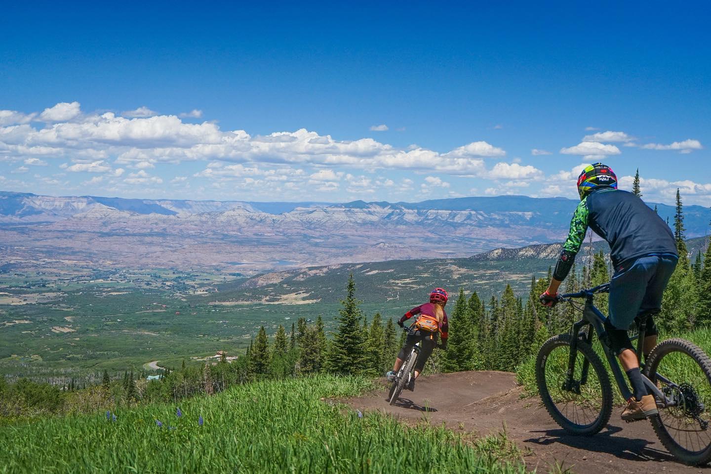 Image of people mountain biking at Powderhorn Ski Resort in Colorado