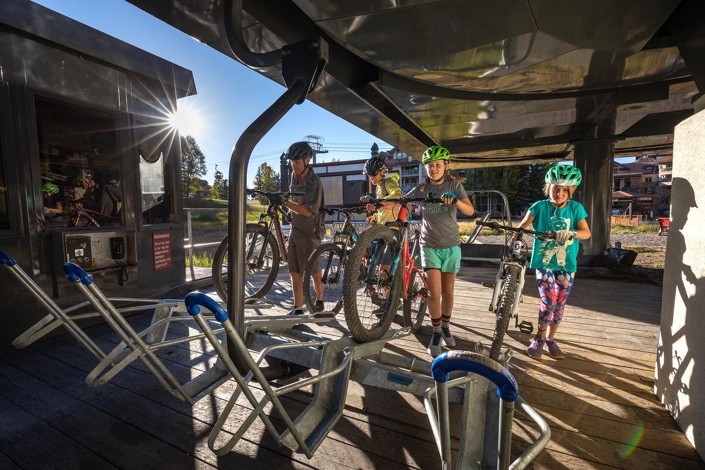 Image of people putting their bikes on the ski lift at Telluride Resort in Colorado