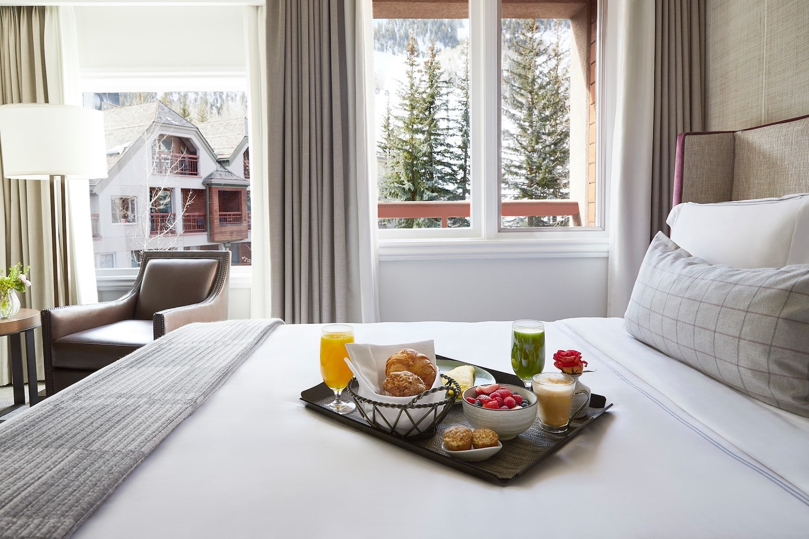 Image of breakfast on a bed at the The Little Nell in Aspen, Colorado