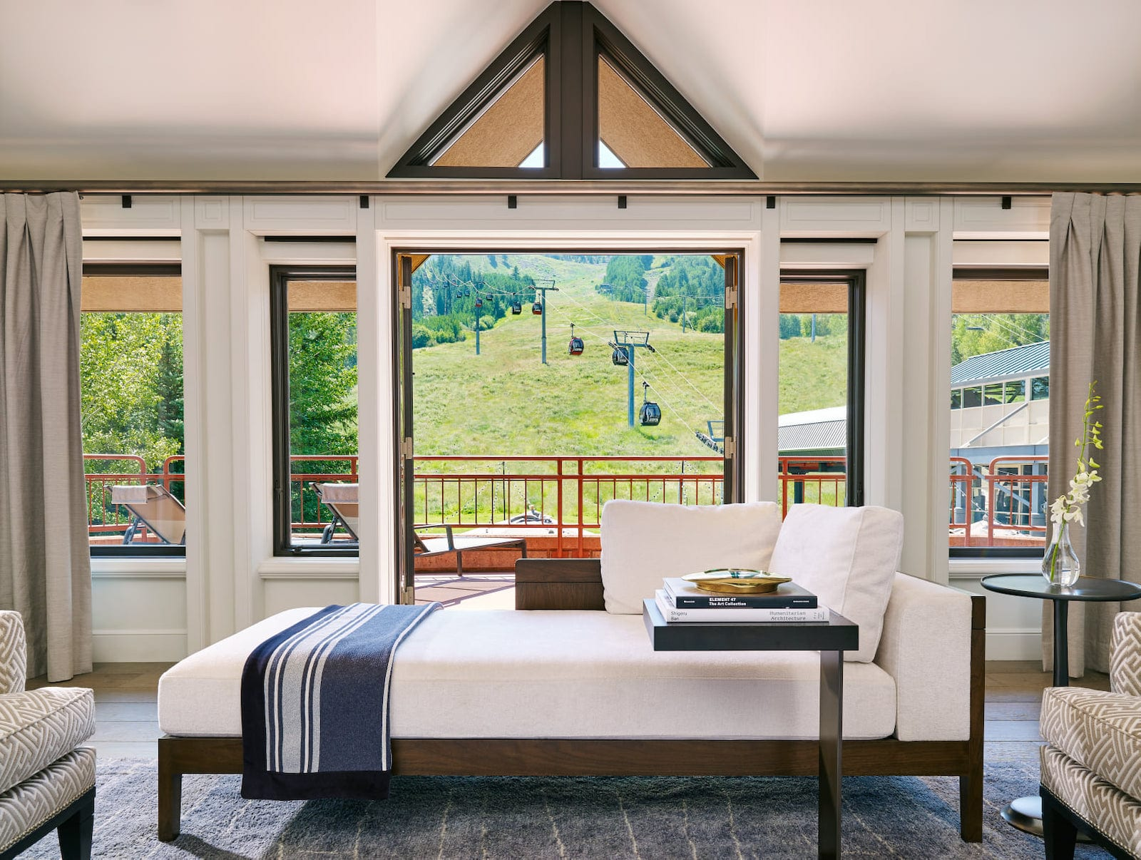 Image of a bed at The Little Nell in Aspen, Colorado looking at the slopes